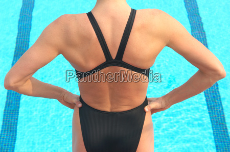 woman standing in front of swimming