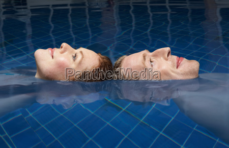 man and woman floating in a