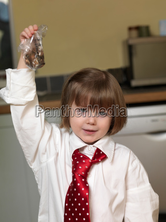 girl holding bag of coins