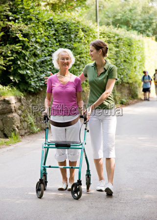 woman walking with senior woman