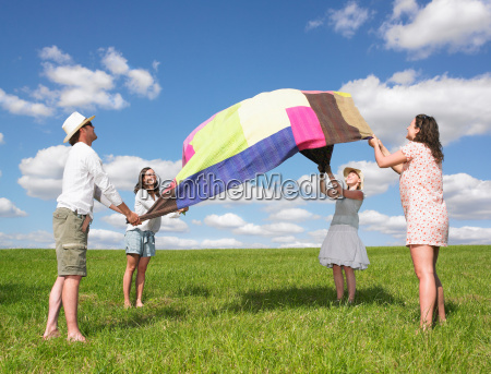 young people with picnic blanket