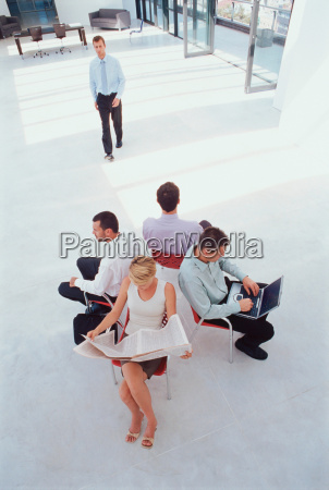 business people working in lobby