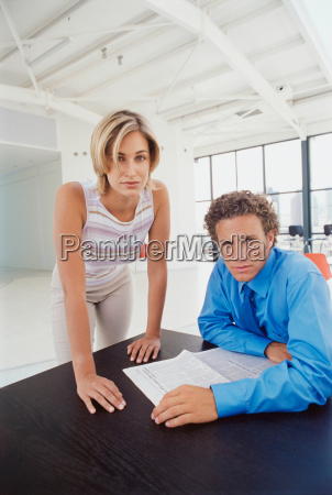 business people at desk in office