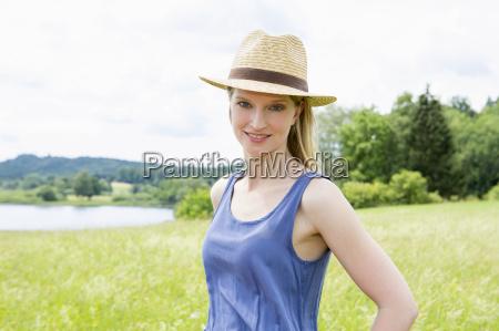 mid adult woman wearing sunhat portrait