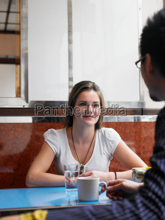 young woman sitting in cafe with