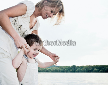mother helping child
