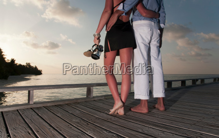 couple standing together on dock