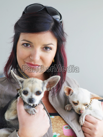 portrait of woman with small dogs