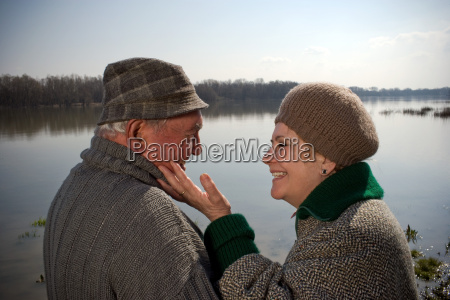 senior couple woman touching mans face