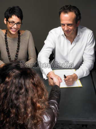 woman shaking hands at interview