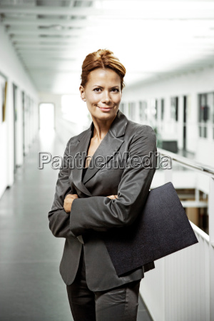 business woman holding a file smiling