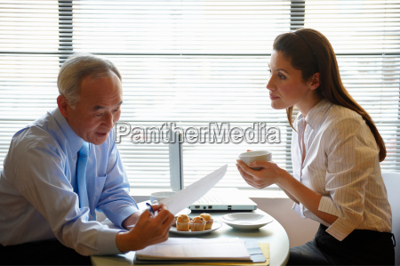 senior man and woman working in