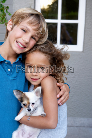 brother and sister with their dog
