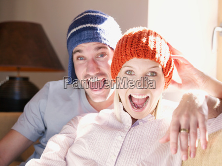 man and woman on sofa in