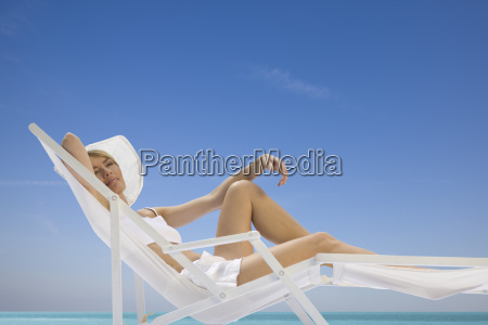 woman lying in a sun lounger