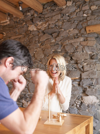 woman and man playing game at