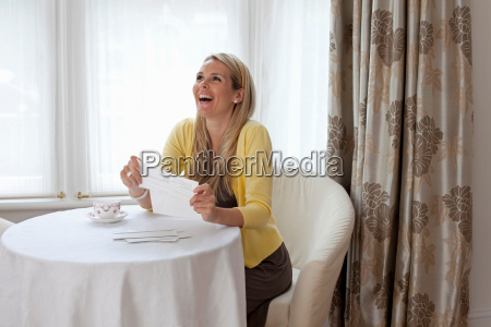 young woman happy about good news