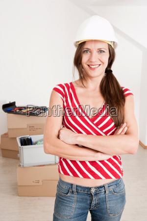 woman wearing hard hat in new