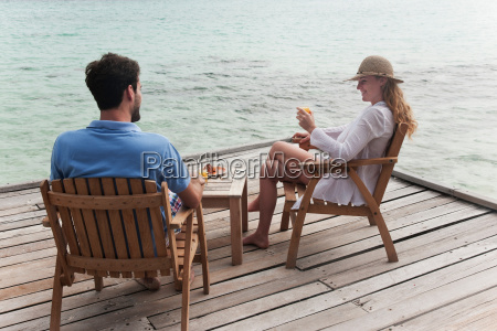 couple eating together on deck
