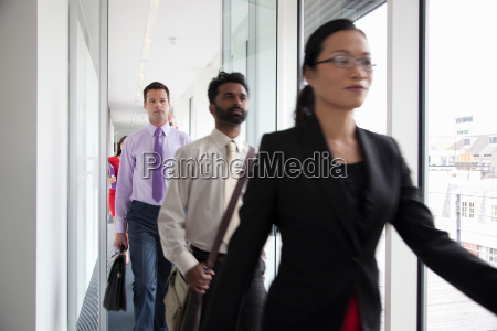 business people rushing past camera