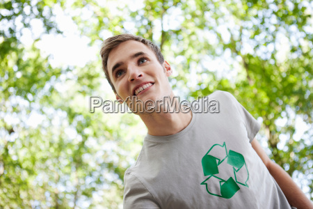 young man with trees in the