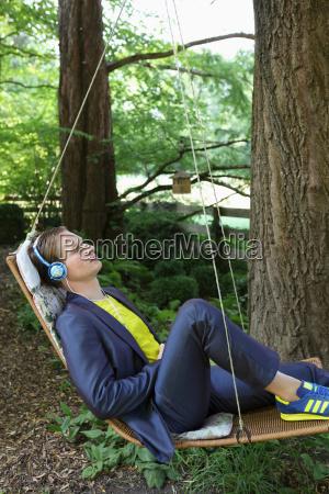 young man relaxing in hammock