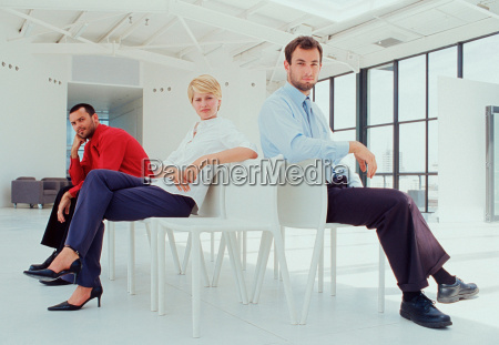business people sitting in lobby