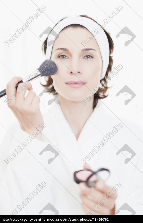 woman, in, bathrobe, applying, makeup - 18459762