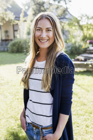 mid adult woman smiling towards camera