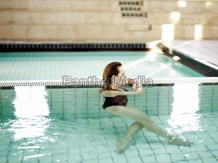 woman standing in swimming pool