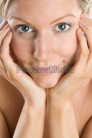 a woman touching her face