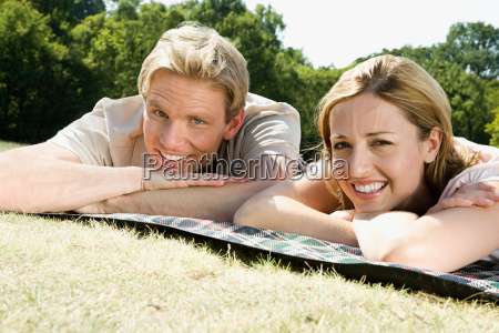 couple lying on blanket