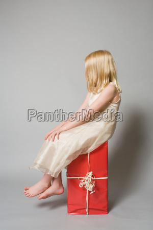 girl sitting on a present