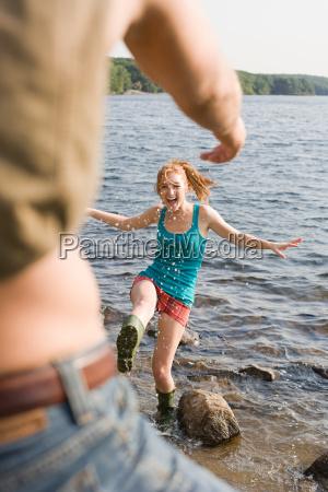 girl splashing in lake