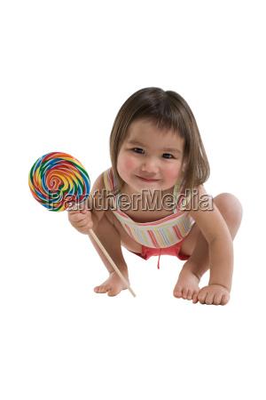 girl holding a lollipop