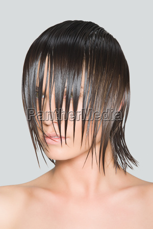 a woman with wet hair covering