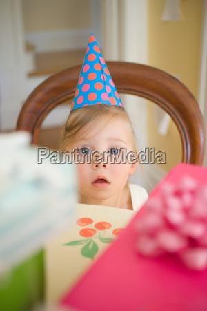 little girl wearing party hat
