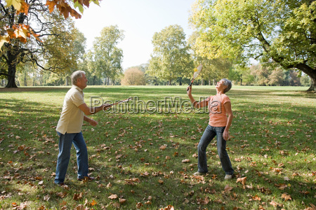 senior couple playing badminton