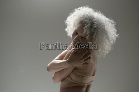 mature woman wearing pink bra