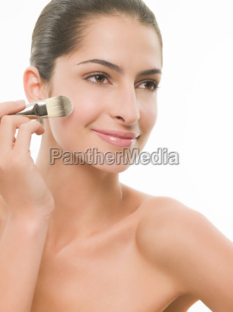 woman with makeup brush
