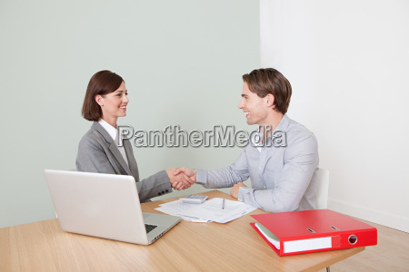 young man shaking hands with financial