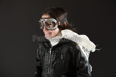 young boy wearing flying goggles dressed
