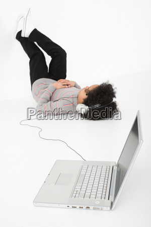 boy listening to music on laptop