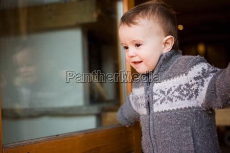 young boy in chalet doorway