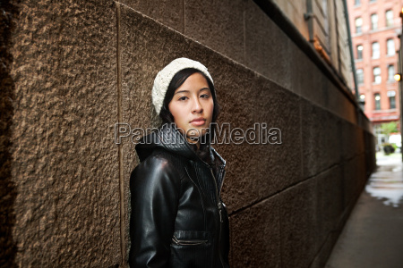 young woman wearing knit hat by