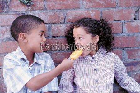 boy and girl sharing ice cream