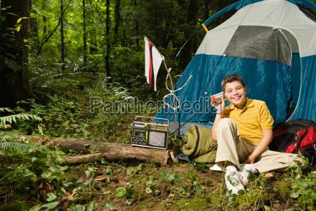 boy at camp with radio