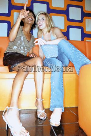 women chatting in nightclub