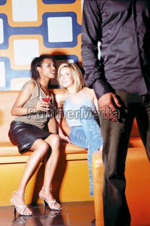 women flirting in nightclub