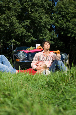 couple in field by car